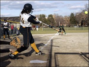Notre Dame's Cassie Gillespie delivers the winning hit in Tuesday afternoon's game against Clay in City League play. The Notre Dame Eagles scored two runs in the bottom of the seventh to beat last year's conference champ Eagles 6-5. Gillespie was 3 for 4 on the day.