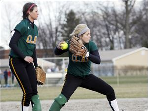 Clay pitcher Cassi Laberdee fields a ground ball and looks to make a play at first in the game.
