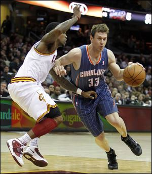 Charlotte Bobcats' Matt Carroll, right, drives around Cleveland Cavaliers' Daniel Gibson in the fourth quarter in Clevela