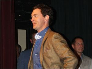 Model Mark Remeis, of AA Green Realty; in background, Ed Whipple, vice president for Student Affairs at BGSU.