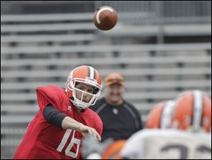 Quarterback Trent Hurley throws a pass.