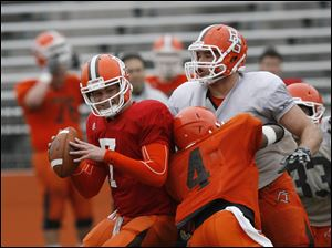 Jordan Hopgood (4) falls into quarterback Matt Schilz (7) while attempting to block defensive tackle Chris Jones.