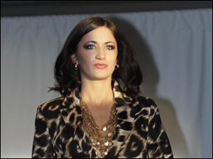 Allison Burns wears a cheetah print skirt suit by Calvin Klein.
