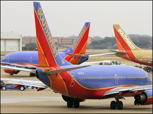Southwest airplanes are seen at Love Field in Dallas in this 2008 file photo.