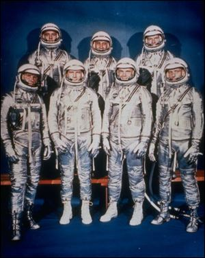 John Glenn and Scott Carpenter, third and fourth from left, bottom row, are the only surviving Mercury astronauts.