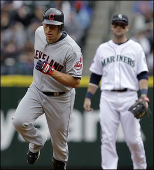 Seattle Mariners second baseman Adam Kennedy, right, watches as Cleveland Indians' Asdrubal Cabrera rounds the bases on a home run in the first inning.