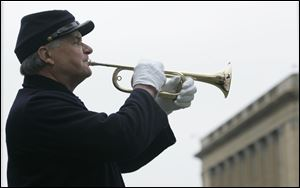 Jim Cherven of Battery H, 1st Ohio Light Artillery, plays Taps as the ceremony ends. The tune was arranged by Union Gen. Daniel Butterfield and was used by both Union and Confederate forces.