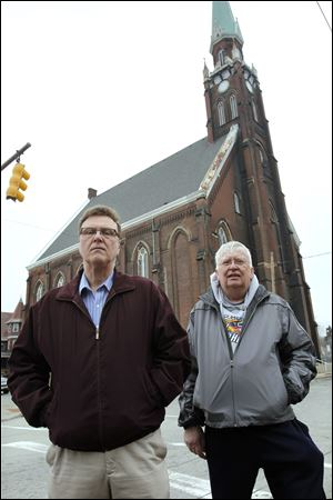 Rick Napierala, left, and Tom Robakowski, outside the former St. Anthony Catholic Church, say they have floated around since the parish's closure.