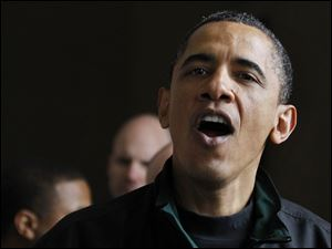 President Barack Obama speaks to visitors at the Lincoln Memorial.