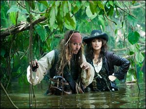 Johnny Depp, left, and Penelope Cruz are shown in a scene from, 'Pirates of the Caribbean: On Stranger Tides.'