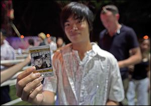 A Vietnamese student shows his checked ticket before entering the one-night-only show at RMIT University in Ho Chi Minh City.