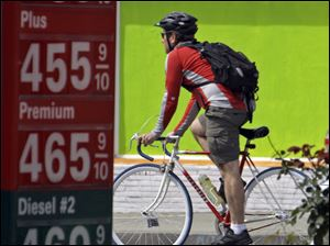 A bicyclist passes a gas station in Los Angeles as fuel costs rise above the $4 mark. With the price of gas above $3.50 a gallon in all but one state, there are signs that Americans are cutting back on driving, reversing a steady increase in demand for fuel as the economy improves. Other modes of mass transportation, such as bus transit, have been an option, while buying and driving more fuel-efficient vehicles also have become more popular.