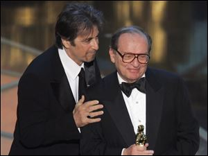 Director Sidney Lumet, right, received an honorary Oscar in 2005, presented by actor Al Pacino, who starred in two of Lumet's films.