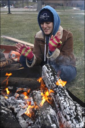 Hannah Jacobs, a social work major at Owens Community College, tries to keep warm.