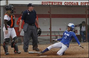 Southview catcher Jess Knepper can only watch as Chelsea Haas scores