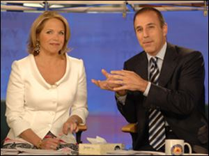 "Katie Couric and Matt Lauer on Couric's last day on NBC's ""Today,"" where Couric returned Wednesday for an interview about her career future."