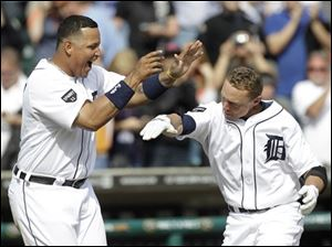 Detroit's Brandon Inge, right, celebrates hitting a walk off home run with Miguel Cabrera against Texas in the ninth inning.