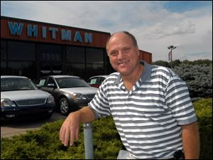 Jon Whitman, in a 2005 file photo, said he is closing Whitman Ford because of his frustration with a costly rezoning battle with Bedford Township.