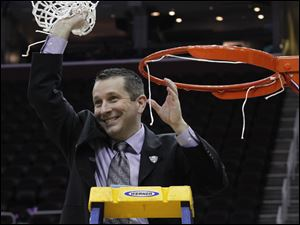 BGSU head coach Curt Miller waves the net after his team defeated Eastern Michigan during the 2011 Mid-American Conference Women's Basketball Final at Quicken Loans Arena in Cleveland, Ohio.
