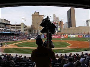 A cotton candy vendor makes his way through the stands at Fifth Third Field.