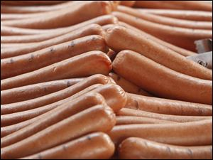 Hot dogs at a concession stand are ready for the fans during the Mud Hens home opener at Fifth Third Field in Toledo.