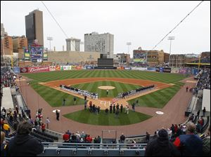 Toledo Mud Hens players, left, and Columbus Clippers players, right, line the field during the National Anthem.