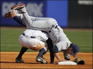 Mud Hens designated hitter Scott Thorman upends Columbus Clippers second baseman Jason Kipnis who makes the out.