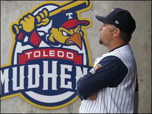 Toledo manager Phil Nevin stands in the Mud Hens dugout.