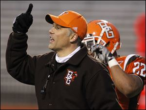 Bowling Green State University football coach Dave Clawson calls plays during the spring game.