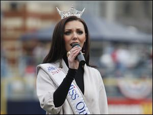 Miss Ohio Becky Minger, a Sylvania native, sings the National Anthem at Fifth Third Field.