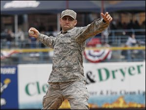Staff Sgt. Tim Fiordaliso representing the 180th Fighter Wing Command Post, the 2010 Air National Guard Command Post of the Year, throws out a ceremonial first pitch prior to the Mud Hens home opener at Fifth Third Field.