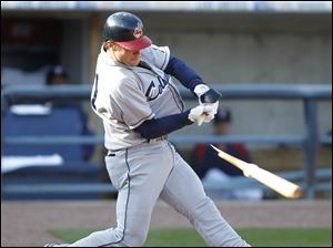 Columbus Clippers player Jason Donald breaks his bat as he hits into a double play during the seventh inning.