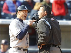 Columbus Clippers manager Mike Sarbaugh argues a call with home plate umpire Manny Gonzalez during the fifth inning of the Mud Hens home opener.