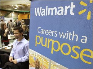 Representatives from Walmart speak to job seekers at a job fair held at Cleveland State University.