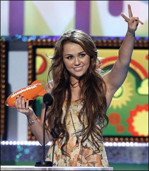 Miley Cyrus, here at the Nickelodeon Kids Choice Awards, is excited for her upcoming tour which will take her to South America and Australia.