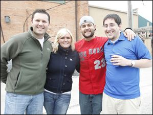 From left: Nick Milam, Kimberly Swan, Ryan Crahan, and Zac Mattell, enjoy a pre-game tailgate before the Mud Hens' home opener.