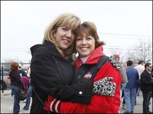 Jenifer Hoogendoorn, left, and Carrie Poll, right, enjoy the pre-game Midland Title party at 23 S. St. Clair before the Mud Hens' home opener.