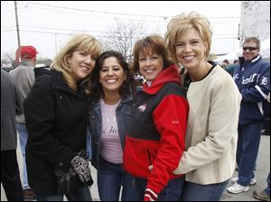 From left: Jenifer Hoogendoorn, Denise Hooven, Carrie Poll, and Mary Jo Bicanovsky, enjoy the pre-game Midland Title party before the Mud Hens' home opener.