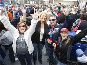 From left: Lauren Kurth, Jackie Klempner, Tim Fisher, and Jennifer Fisher enjoy a pre-game drink on the patio of Jed's downtown before the Mud Hen's home opener at Fifth Third Field on April 14, 2011.