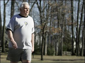 Tom Pfau of Sylvania walks at Olander Park. He exercises daily to keep his Type 2 diabetes under control.