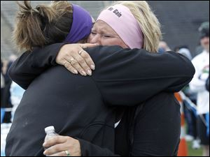 First time runner Nita McDaniel, left, hugs her daughter and running partner Tiffany McDaniel after crossing the finish line.