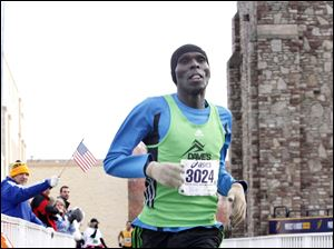 Julius Kiptoo, Kenya native and current Toledo resident, crosses the finish line to take first place in the half marathon.