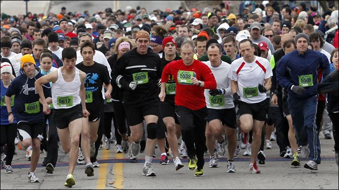 Glass City Marathon 5K start The 5K runners take off at the start of the Glass City Marathon. Louis Pablo Guardiola, left #5612, from Fremont, came in first place.