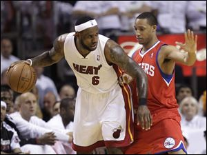 Miami's LeBron James (6) drives up against Philadelphia's Evan Turner during the first quarter of Game 2.