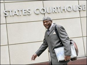 Retired Minnesota Vikings Hall of Fame player Carl Eller arrives Tuesday at the federal courthouse in Minneapolis where the NFL and its locked-out players continue court-ordered mediation.