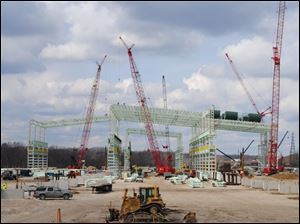 The steel skeleton of the new V&M Star rolling mill takes shape in Youngstown. The plant's construction next to its existing operation is expected to more than double the mill's work force.