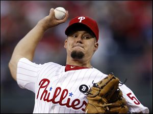 Philadelphia Phillies starting pitcher Joe Blanton throws Monday during the first inning of a baseball game against the Milwaukee Brewers in Philadelphia.