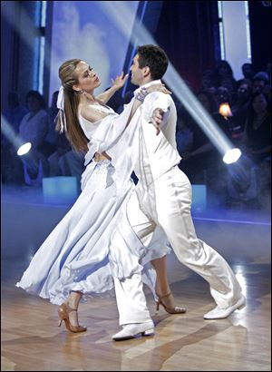Petra Nemcova, left, and her partner Dmitry Chaplin perform on the celebrity dance competition series, 'Dancing with the Stars.'