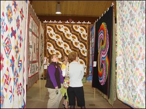 Quilts will be on display in Founders Hall at Sauder Village through May 1.