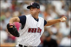 Toledo Mud Hens pitcher Andrew Oliver fires in a pitch.